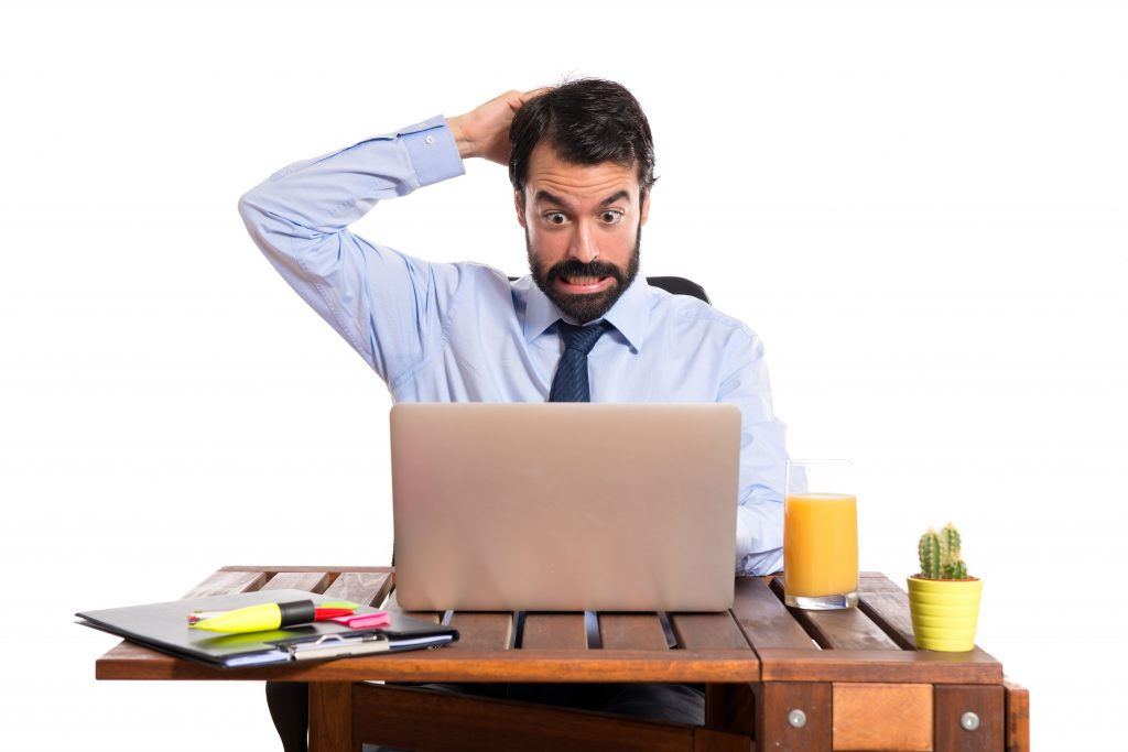 Businessman in his office having problem